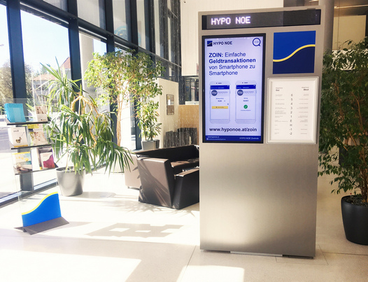 foyer of hypo noe headquarters in austria with spinetix digital signage totem