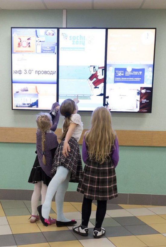 digital interactive touch screens in a school hall