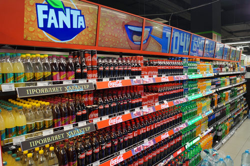 coca-cola digital retail shelf with spinetix led video wall