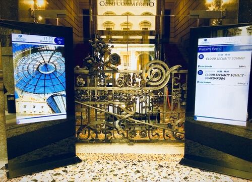 spinetix digital signage totems at the confcommercio building in milan