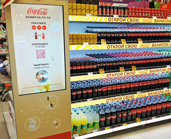 spinetix digital signage for retail installed by coca cola in a supermarket