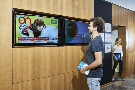 goethe university digital signage with a student in front of display